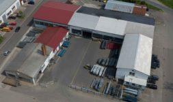 Außengelände der Firma Pudenz und Heddergott Industrieanstrich GmbH aus Wilbich, Luftaufnahme